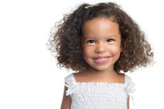 Little girl with an afro hairstyle smiling Royalty Free Stock Photos