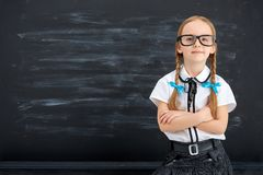 Little girl against blackboard. Royalty Free Stock Images