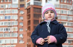 Little girl against new building Royalty Free Stock Photo