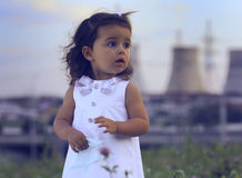 Little girl against power station. Royalty Free Stock Photography