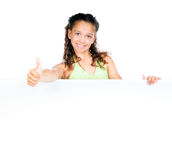 Little girl against a white blank Royalty Free Stock Images