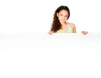 Little girl against a white blank Stock Image