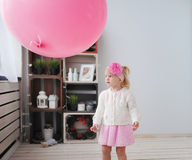 Little girl and air pink sphere Royalty Free Stock Image