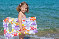 Little girl with airbed Royalty Free Stock Photo
