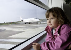 Little girl in airport Royalty Free Stock Image