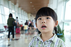 Little girl at the airport terminal. Little girl in boarding room at the airport terminal Stock Photo