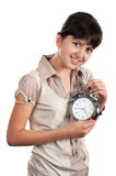 Little girl with an alarm clock Stock Image
