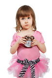 Little girl with alarm clock in hands. Stock Photos