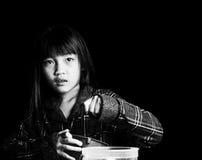 Little girl alone in the dark Stock Photos