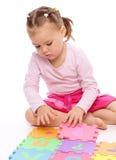Little girl with alphabet Stock Photo