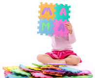 Little girl with alphabet Royalty Free Stock Photos