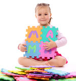 Little girl with alphabet Stock Image