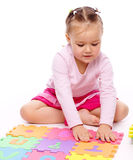 Little girl with alphabet Stock Images