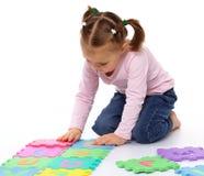 Little girl with alphabet Stock Photos