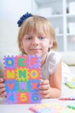 Little girl with alphabet puzzle Stock Photo