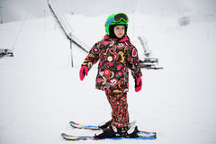 Little girl on Alpine ski Stock Photos