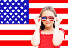 Little girl and American flag Stock Photos