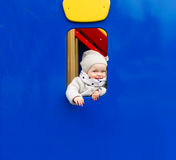 The little girl is in an amusement park. royalty free stock image