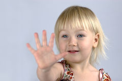 Little girl analyzing her palm Royalty Free Stock Photo