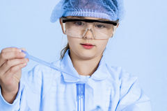Little girl  analyzing a  sample. Royalty Free Stock Photo