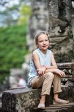 Angkor Wat temple. Little girl in ancient Angkor Wat temple in Siem Reap, Cambodia Stock Image
