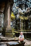 Angkor Wat temple. Little girl in ancient Angkor Wat temple in Siem Reap, Cambodia Royalty Free Stock Photo