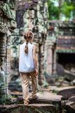 Child in Preah Khan temple. Little girl at ancient Preah Khan temple in Angkor Archaeological area in Cambodia Royalty Free Stock Photo