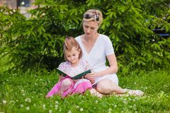 Little Girl And Her Mother Reading A Book Royalty Free Stock Image