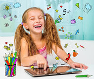 Little Girl And Her Tablet Royalty Free Stock Photo
