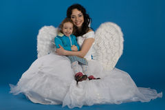 Little girl with an angel Royalty Free Stock Image