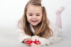 A little girl angel with a candle. A beautiful little girl angel with a candle Royalty Free Stock Photo