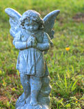 Little girl angel stone Royalty Free Stock Images