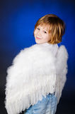 Little girl with angel wings. Little blond girl with angel wings on a blue background Stock Photo