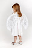 Little girl with angel wings in the studio Stock Image