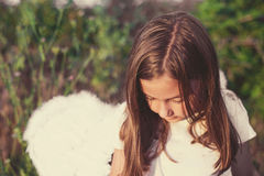 Little girl with angel wings and white dress Stock Photo