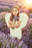 Little girl with angel wings and white dress Stock Photography