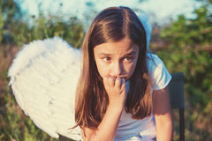 Little girl with angel wings and white dress Stock Image