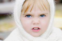 The little girl with an angry face Stock Image