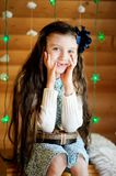 Little girl in anticipation of Christmas night Royalty Free Stock Image
