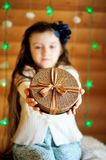 Little girl in anticipation of Christmas night Royalty Free Stock Photos