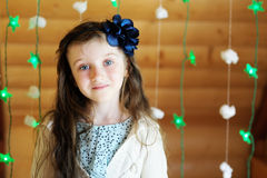 Little girl in anticipation of Christmas night Stock Photo