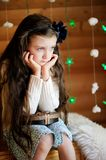 Little girl in anticipation of Christmas night Royalty Free Stock Photography