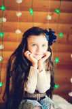 Little girl in anticipation of Christmas night Stock Images