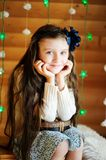 Little girl in anticipation of Christmas night Stock Photography