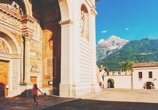 Little girl in Aosta. Aosta Cathedral aka Santa Maria Assunta and San Giovanni Battista church in Aosta, Italy Stock Image