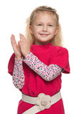 Little girl applauds Stock Images
