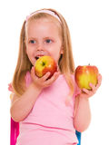 Little girl with apple. Stock Photo