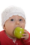 A little girl with an apple. Royalty Free Stock Photos