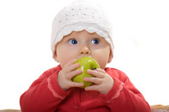 A little girl with an apple. Stock Photos