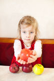 Little girl with apple. Pretty little girl with apple Royalty Free Stock Images